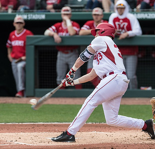 Arkansas catcher Grant Koch (33) bats during the opening day baseball game between Arkansas and Miami (Ohio) on Friday. 2/17/2017.  (Alan Jamison, Nate Allen Sports Service)