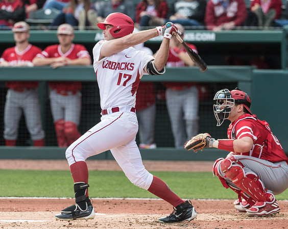 Arkansas outfielder Luke Bonfield (17) gets a hit during the opening day baseball game between Arkansas and Miami (Ohio) on Friday. 2/17/2017.  (Alan Jamison, Nate Allen Sports Service)