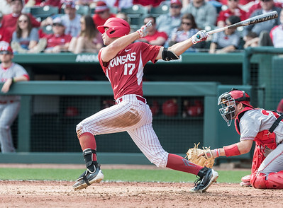 Arkansas outfielder Luke Bonfield (17) hits during a baseball game between Arkansas and Miami (Ohio) on Saturday. 2/18/2017.  (Alan Jamison, Nate Allen Sports Service)