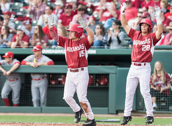 Arkansas outfielder Jake Arledge (15) and Arkansas outfielder Dominic Fletcher (28) celebrate a run during a baseball game between Arkansas and Miami (Ohio) on Saturday. 2/18/2017.  (Alan Jamison, Nate Allen Sports Service)
