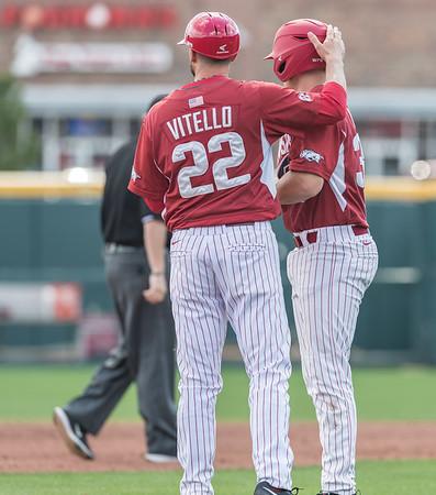 Arkansas coach Tony Vitello  congratulates Grant Koch (33) on a two RBI hit during a baseball game between Arkansas and Miami (Ohio) on Saturday. 2/18/2017.  (Alan Jamison, Nate Allen Sports Service)