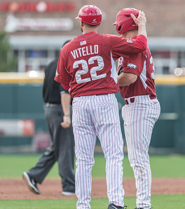 Arkansas coach Tony Vitello  congratulates Grant Koch (33) on a two RBI hit during a baseball game between Arkansas and Miami (Ohio) on Saturday. 2/18/2017.  (Alan Jamison, Nate Allen Sports Service)