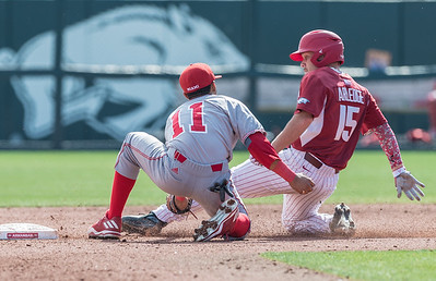 Arkansas outfielder Jake Arledge (15) is tagged out by Miami (Ohio) outfielder Carlos Texidor (11) while attempting to steal second base during a baseball game between Arkansas and Miami (Ohio) on Saturday. 2/18/2017.  (Alan Jamison, Nate Allen Sports Service)