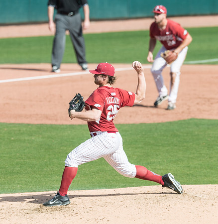 Arkansas pitcher Dominic Taccolini (25) pitches in relief during a baseball game between Arkansas and Miami (Ohio) on Saturday. 2/18/2017.  (Alan Jamison, Nate Allen Sports Service)