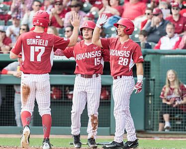 Arkansas outfielder Luke Bonfield (17) and Arkansas outfielder Jake Arledge (15) score during a baseball game between Arkansas and Miami (Ohio) on Saturday. 2/18/2017.  (Alan Jamison, Nate Allen Sports Service)