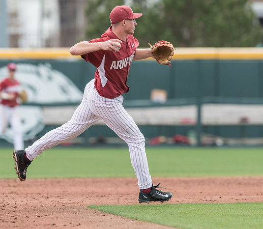 Arkansas infielder Jax Biggers (9) fields during a baseball game between Arkansas and Miami (Ohio) on Saturday. 2/18/2017.  (Alan Jamison, Nate Allen Sports Service)