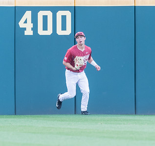 Arkansas outfielder Dominic Fletcher (28) fields a long fly ball during a baseball game between Arkansas and Miami (Ohio) on Saturday. 2/18/2017.  (Alan Jamison, Nate Allen Sports Service)