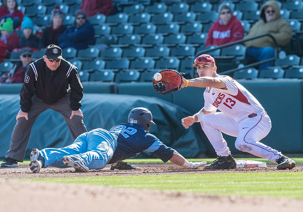 Arkansas infielder Jordan McFarland (13) prepares to tag a Rhode Island base runner during a baseball game between Arkansas and Rhode Island on Friday, 3/10/2017.  (Alan Jamison, Nate Allen Sports Service)