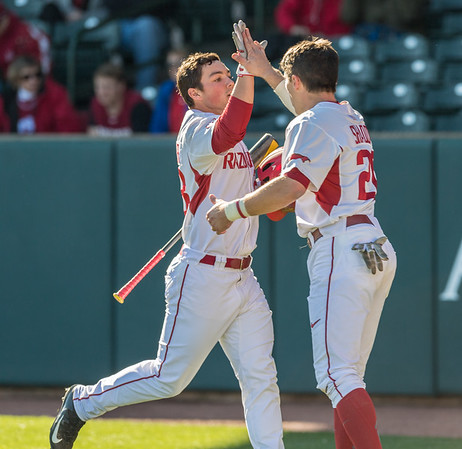 Arkansas outfielder Dominic Fletcher (28) celebrates a home run with Arkansas catcher Carson Shaddy (20) during a baseball game between Arkansas and Rhode Island on Friday, 3/10/2017.  (Alan Jamison, Nate Allen Sports Service)
