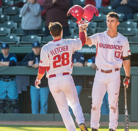 Arkansas outfielder Dominic Fletcher (28) celebrates a home run with Arkansas infielder Jordan McFarland (13) during a baseball game between Arkansas and Rhode Island on Friday, 3/10/2017.  (Alan Jamison, Nate Allen Sports Service)