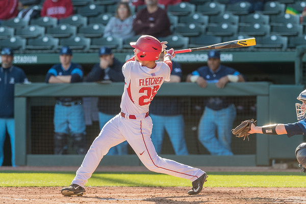 Arkansas outfielder Dominic Fletcher (28) hits a home run during a baseball game between Arkansas and Rhode Island on Friday, 3/10/2017.  (Alan Jamison, Nate Allen Sports Service)