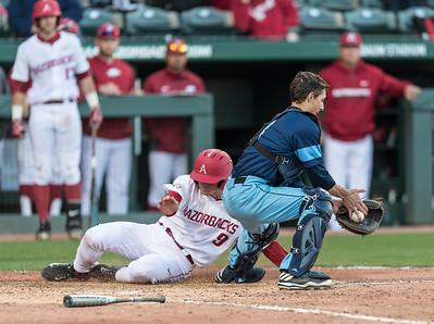 Arkansas infielder Jax Biggers (9) scores during a baseball game between Arkansas and Rhode Island on Friday, 3/10/2017.  (Alan Jamison, Nate Allen Sports Service)