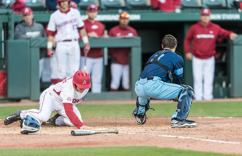 Arkansas infielder Jax Biggers (9) scores during a baseball game between Arkansas and Rhode Island on Friday, 3/10/2017.  (Alan Jamison, Nate Allen Sports Service)