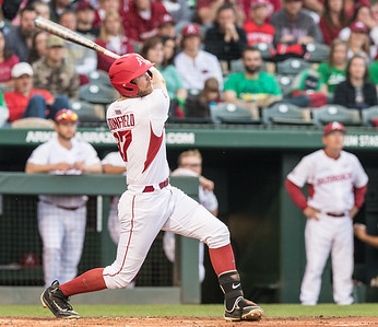 Arkansas outfielder Luke Bonfield (17) homers during a baseball game between Arkansas and Mississippi State on Friday, 3/17/2017.  (Alan Jamison, Nate Allen Sports Service)