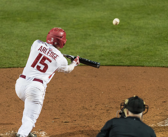 Arkansas outfielder Jake Arledge (15) bunts during a baseball game between Arkansas and Mississippi State on Friday, 3/17/2017.  (Alan Jamison, Nate Allen Sports Service)