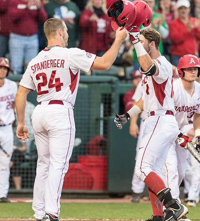 Arkansas catcher Chad Spanberger (24) congratulates Arkansas outfielder Luke Bonfield (17) on Bonfield's home run during a baseball game between Arkansas and Mississippi State on Friday, 3/17/2017.  (Alan Jamison, Nate Allen Sports Service)