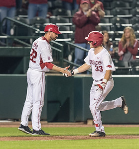 Arkansas catcher Grant Koch (33) is congratulated on his home run by Assistant Coach Tony Vitello during a baseball game between Arkansas and Mississippi State on Friday, 3/17/2017.  (Alan Jamison, Nate Allen Sports Service)