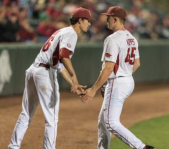Arkansas pitcher Blaine Knight (16) congratulates Arkansas pitcher Kevin Kopps (45) on his pitching performance during a baseball game between Arkansas and Mississippi State on Friday, 3/17/2017.  (Alan Jamison, Nate Allen Sports Service)