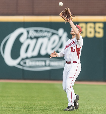 Arkansas outfielder Jake Arledge (15) catches a fly ball during a baseball game between Arkansas and Mississippi State on Friday, 3/17/2017.  (Alan Jamison, Nate Allen Sports Service)