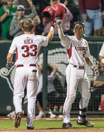 Arkansas catcher Carson Shaddy (20) and Arkansas catcher Grant Koch (33) celebrate Koch's home run during a baseball game between Arkansas and Mississippi State on Friday, 3/17/2017.  (Alan Jamison, Nate Allen Sports Service)