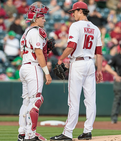 Arkansas pitcher Blaine Knight (16) confers with Arkansas catcher Grant Koch (33) during a baseball game between Arkansas and Mississippi State on Friday, 3/17/2017.  (Alan Jamison, Nate Allen Sports Service)