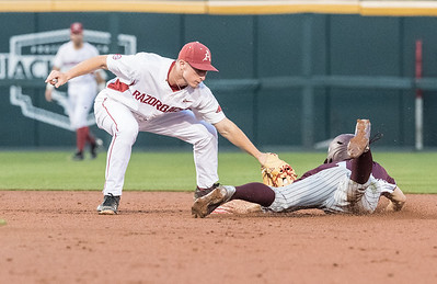 Arkansas infielder Jax Biggers (9) tags out Mississippi St. outfielder Jake Mangum (15) at second during a baseball game between Arkansas and Mississippi State on Friday, 3/17/2017.  (Alan Jamison, Nate Allen Sports Service)