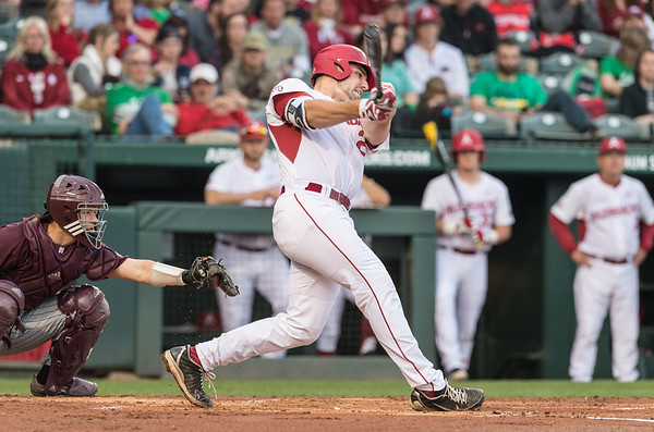 Arkansas catcher Chad Spanberger (24) hits during a baseball game between Arkansas and Mississippi State on Friday, 3/17/2017.  (Alan Jamison, Nate Allen Sports Service)