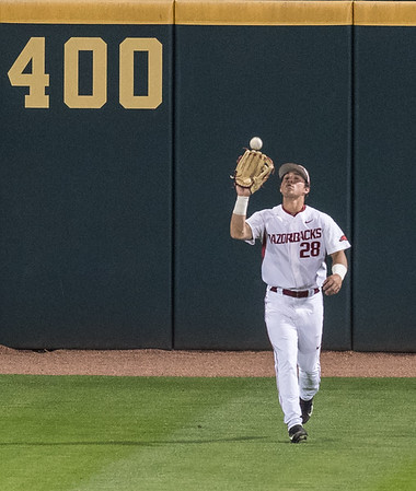 Arkansas outfielder Dominic Fletcher (28) catches a long fly ball during a baseball game between Arkansas and LSU on Friday, 4/7/2017.  (Alan Jamison, Nate Allen Sports Service)