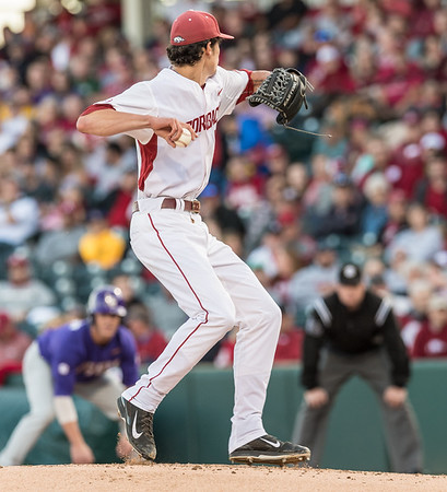 Arkansas pitcher Blaine Knight (16) throws to first base during a baseball game between Arkansas and LSU on Friday, 4/7/2017.  (Alan Jamison, Nate Allen Sports Service)