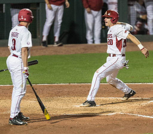 Arkansas catcher Carson Shaddy (20) scores a run during a baseball game between Arkansas and LSU on Friday, 4/7/2017.  (Alan Jamison, Nate Allen Sports Service)