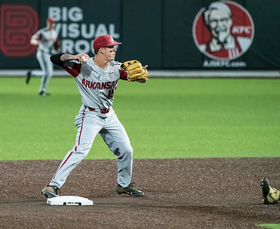 Casey Martin throws to first for the second half of a double play during a baseball game between the Arkansas Razorbacks and the Vanderbilt Commodores on Friday, April 12, 2019, at Hawkins Stadium.  (Alan Jamison, Nate Allen Sports Service)