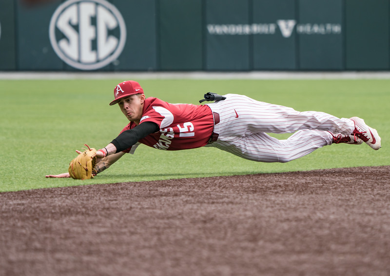 Casey Martin dives to stop a ball during a baseball game between the Arkansas Razorbacks and the Vanderbilt Commodores on Saturday, April 13, 2019, at Hawkins Stadium.  (Alan Jamison, Nate Allen Sports Service)