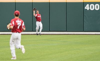 Dominic Fletcher catches a fly ball during a baseball game between the Arkansas Razorbacks and the Vanderbilt Commodores on Saturday, April 13, 2019, at Hawkins Stadium.  (Alan Jamison, Nate Allen Sports Service)
