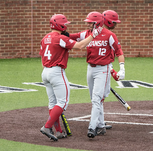 Casey Opitz celebrates a home run with Trevor Ezell during a baseball game between the Arkansas Razorbacks and the Vanderbilt Commodores on Sunday, April 14, 2019, at Hawkins Stadium.  (Alan Jamison, Nate Allen Sports Service)