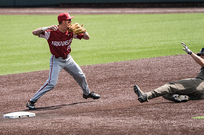 Casey Martin completes a double play during a baseball game between the Arkansas Razorbacks and the Vanderbilt Commodores on Sunday, April 14, 2019, at Hawkins Stadium.  (Alan Jamison, Nate Allen Sports Service)