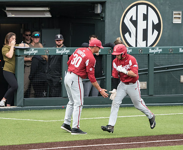 Casey Opitz celebrates a home run with Assistant Coach Nate Thompson during a baseball game between the Arkansas Razorbacks and the Vanderbilt Commodores on Sunday, April 14, 2019, at Hawkins Stadium.  (Alan Jamison, Nate Allen Sports Service)