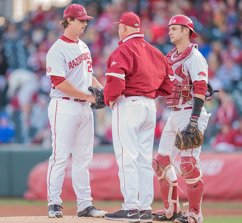 Arkansas pitching coach Dave Jorn visits the mound to talk to starting pitcher Arkansas pitcher Dominic Taccolini (25) during a baseball game between Arkansas and Missouri on 4-1-16.  (Alan Jamison, Nate Allen Sports Service)