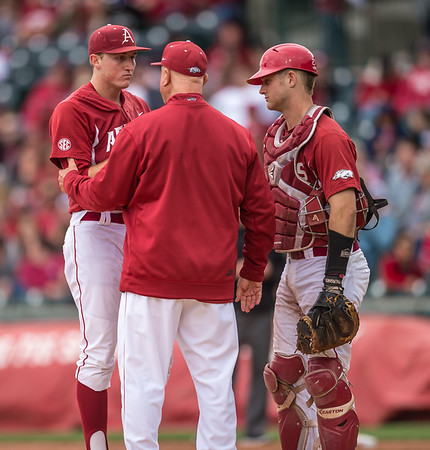 Arkansas pitching coach Dave Jorn meets with Zach Jackson on the mound during a baseball game between Arkansas and Florida on 4/16/2016.   (Alan Jamison, Nate Allen Sports Service)
