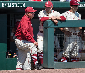 Arkansas pitching coach Dave Jorn talks to head coach Dave Van Horn in the dugout during a baseball game between Arkansas and Missouri on 4-3-16.  (Alan Jamison, Nate Allen Sports Service)