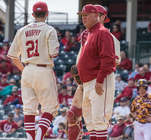 Arkansas pitching coach Dave Jorn talks to Kacey Murphy as he looks toward the bullpen during a baseball game between Arkansas and Central Michigan on 2-21-16.   (Alan Jamison, Nate Allen Sports Service)