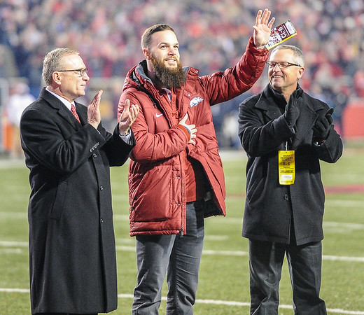 Former Arkansas Razorback pitcher Dallas Keuchel was recognized for his winning of the American League Cy Young award - shown with Athletic Director Jeff Long and baseball head coach Dave Van Horn during the football game between Arkansas and Mississippi State on November 21, 2015.    (Alan Jamison, Nate Allen Sports Service)