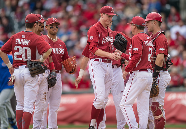 Arkansas pitcher Zach Jackson (32) surrenders the ball to head coach Dave Van Horn during a baseball game between Arkansas and Florida on 4/16/2016.   (Alan Jamison, Nate Allen Sports Service)