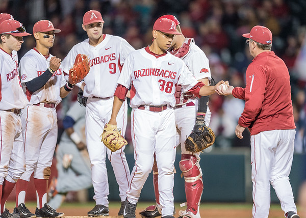 Arkansas pitcher Jordan Rodriguez (38) surrenders the ball to Arkansas head coach Dave Van Horn during a baseball game between Arkansas and Auburn on 3-25-16.  (Alan Jamison, Nate Allen Sports Service)