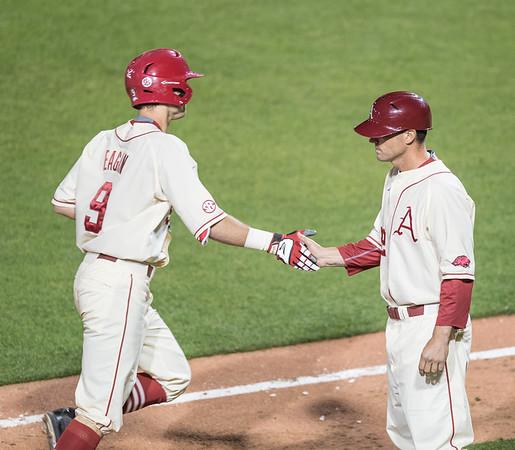 Arkansas coach Tony Vitello congratulates Clark Eagan on Eagan's home run during a baseball game between Alabama and Arkansas on May 14, 2016.   (Alan Jamison)