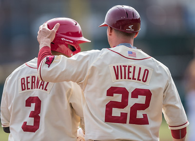 Arkansas assistant coach Tony Vitello talks to Michael Bernal at third base during a baseball game between Arkansas and Central Michigan on 2-21-16.   (Alan Jamison, Nate Allen Sports Service)
