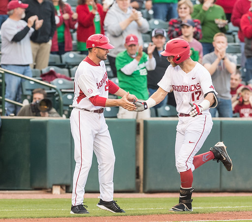 Arkansas outfielder Luke Bonfield (17) is congratulated by Assistant Coach Tony Vitello as he rounds third base after hitting a home run during a baseball game between Arkansas and Mississippi State on Friday, 3/17/2017.  (Alan Jamison, Nate Allen Sports Service)
