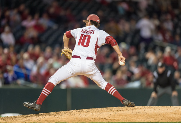 Arkansas pitcher Josh Alberius (10) pitches during a baseball game between Arkansas and Florida on 4/14/2016.   (Alan Jamison, Nate Allen Sports Service)