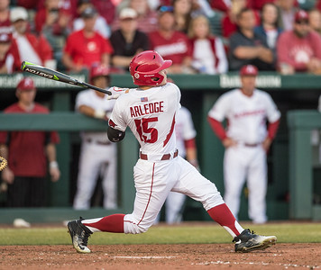 Arkansas outfielder Jake Arledge (15) bats during a baseball game between Arkansas and Central Michigan on 2-19-16.   (Alan Jamison, Nate Allen Sports Service)