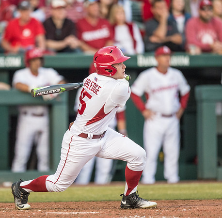 Arkansas outfielder Jake Arledge (15) hits the ball during a baseball game between Arkansas and Central Michigan on 2-19-16.   (Alan Jamison, Nate Allen Sports Service)