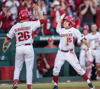 Arkansas outfielder Jake Arledge (15) celebrates a run with Arkansas outfielder Jack Benninghoff (26) during a baseball game between Arkansas and Central Michigan on 2-19-16.   (Alan Jamison, Nate Allen Sports Service)